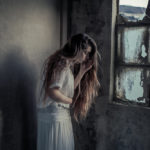 Photo of Elisa Imperi of a girl with blonde long hair in an abandoned space